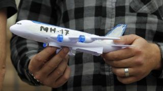 An activist holds symbolic Malaysia Airlines MH17 plane model during a protest of human rights activists and former Ukrainian prisoners of war (POWs) called 'No amnesty for Kremlin criminals', near the Russian Embassy in Kiev, Ukraine, on 11 May, 2019. The activists protest against amnesty for pro-Russian separatists in the separatist self-proclaimed republics, and demand Ukrainian Parliament to vote a law on crimes. (Photo by STR/NurPhoto)
