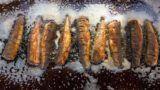 Budapest, 2015. február 19. Hekktörzsek sülnek egy standon a Budapesti Halfesztiválon a Vajdahunyadvárban 2015. február 19-én. MTI Fotó: Mohai Balázs