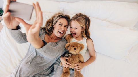 Image: 73848006, Happy young mother taking selfie with her daughter. Young family taking selfie on bed at home., Place: Hungary, License: Rights managed, Model Release: No or not aplicable, Property Release: Yes, Credit: smagpictures.com
