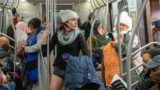 NEW YORK, NY - JANUARY 13: A woman rides the F subway line during the 18th annual No Pants subway ride on January 13, 2019 in New York City. 24 cities participate in the annual event arranged by Improv Everywhere a New York city based comedy collective. (Photo by David 'Dee' Delgado/Getty Images)