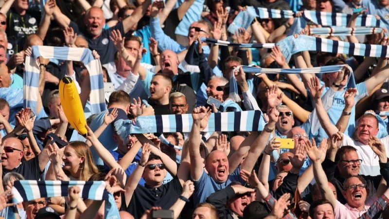 BRIGHTON, ENGLAND - MAY 12: Fans of Manchester City during the celebrations of becoming 2019 Champions after the Premier League match between Brighton & Hove Albion and Manchester City at American Express Community Stadium on May 12, 2019 in Brighton, United Kingdom. (Photo by Matthew Ashton - AMA/Getty Images)