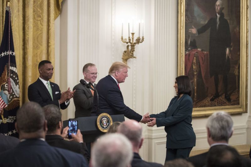Reality star and activist Kim Kardashian West, right, shakes hands with U.S. President Donald Trump before speaking about a second chance hiring and re-entry initiative at an event in the East Room of the White House in Washington, D.C., U.S., on Thursday June 13, 2019. Kardashian West took a star turn at the White House on Thursday to promote efforts to help those leaving prison get jobs and stay on track. Photographer: Sarah Silbiger/Bloomberg via Getty Images