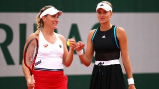 PARIS, FRANCE - MAY 30: Kristina Mladenovic of France and partner Timea Babos of Hungary during their doubles match against Xinyu Jiang of China and Qiang Wang of China during Day five of the 2019 French Open at Roland Garros on May 30, 2019 in Paris, France. (Photo by Clive Brunskill/Getty Images)