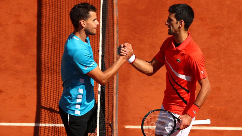 PARIS, FRANCE - JUNE 08: Dominic Thiem of Austria embraces Novak Djokovic of Serbia following victory in their mens singles semi-final match during Day fourteen of the 2019 French Open at Roland Garros on June 08, 2019 in Paris, France. (Photo by Clive Brunskill/Getty Images)