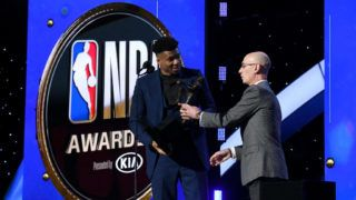 SANTA MONICA, CALIFORNIA - JUNE 24: (L-R) Giannis Antetokounmpo accepts the Kia NBA Most Valuable Player award from NBA Commissioner Adam Silver onstage during the 2019 NBA Awards presented by Kia on TNT at Barker Hangar on June 24, 2019 in Santa Monica, California. (Photo by Michael Kovac/Getty Images for Turner Sports)