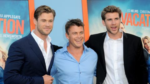 """WESTWOOD, CA - JULY 27:  Actors/brothers Liam Hemsworth, Luke Hemsworth and Chris Hemsworth arrive for the Premiere Of Warner Bros. Pictures' """"Vacation"""" held at Regency Village Theatre on July 27, 2015 in Westwood, California.  (Photo by Albert L. Ortega/Getty Images)"""