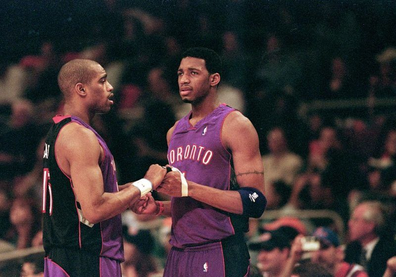 23 Apr 2000: Vince Carter #15 of the Toronto Raptors shakes hands with teammate Tracy McGrady #1 during round one of the NBA Playoffs against the New York Knicks at the Madison Square Garden in New York. The Knicks defeated the Raptors 92-88.   Mandatory Credit: Ezra O. Shaw  /Allsport