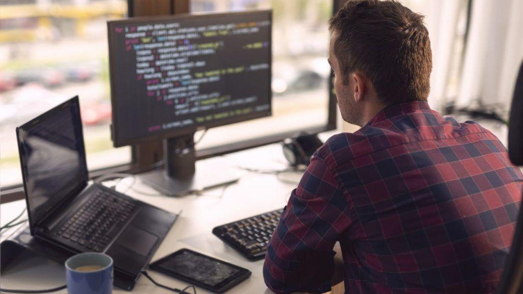Software developer working in a modern office