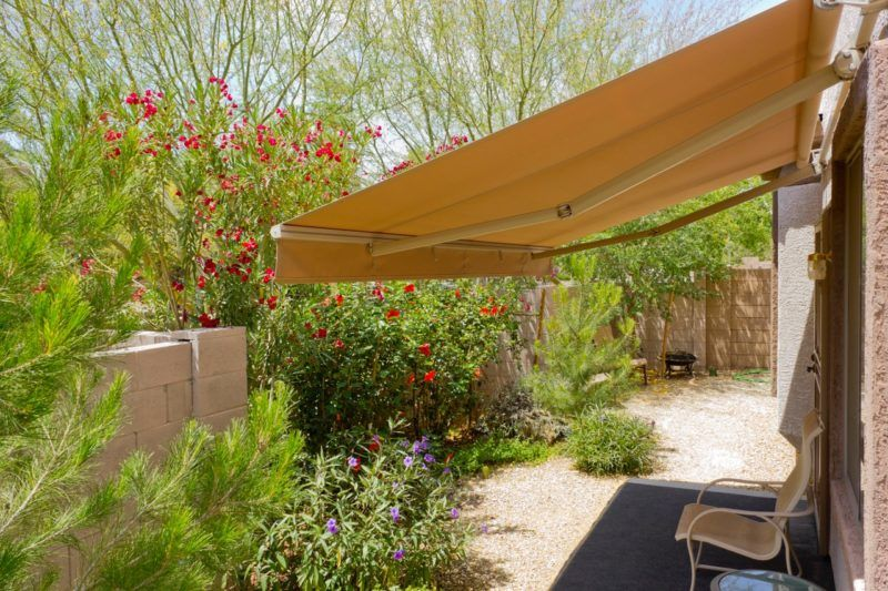 Arizona backyard with automatic retractable awning for extra shade