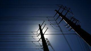 Backlit power lines pulsing energy into the Las Vegas strip.  Bzzzzzzzzzt!