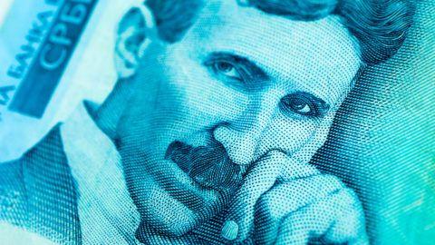 Serbia money RSD dinar cash, macro view, portrait of scientist Nikola Tesla.