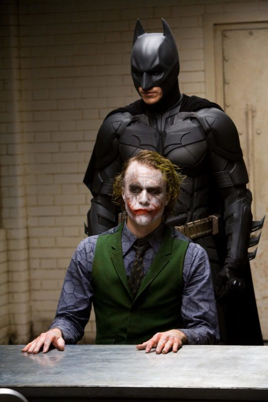 RELEASE DATE: 18 July 2008. MOVIE TITLE: The Dark Knight - STUDIO: Legendary Pictures. PLOT: Batman and James Gordon join forces with Gotham's new District Attorney, Harvey Dent, to take on a psychotic bank robber known as The Joker, whilst other forces plot against them, and Joker's crimes grow more and more deadly. PICTURED: CHRISTIAN BALE  as Bruce Wayne / Batman and HEATH LEDGER as The Joker.