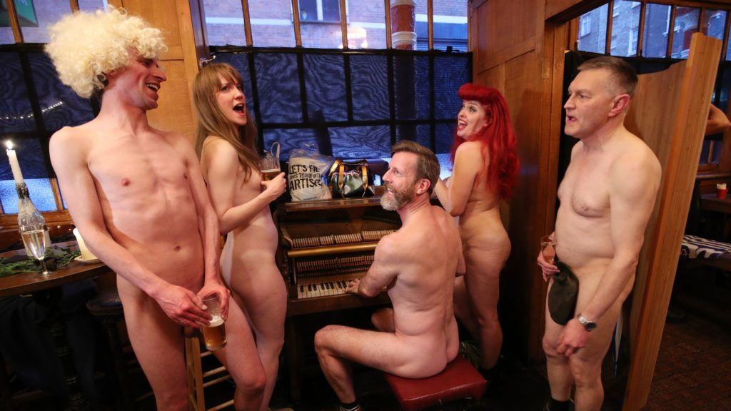 NOTE NUDITY (left to right) Jacob Bloomfield, Maria Beadell, pianist Luke Meredith, Emma Ruth and Davidos Pass, taking part in London's first nudist pub singalong at the Coach And Horses in Soho. London's first nudist pub singalong  June , 2019