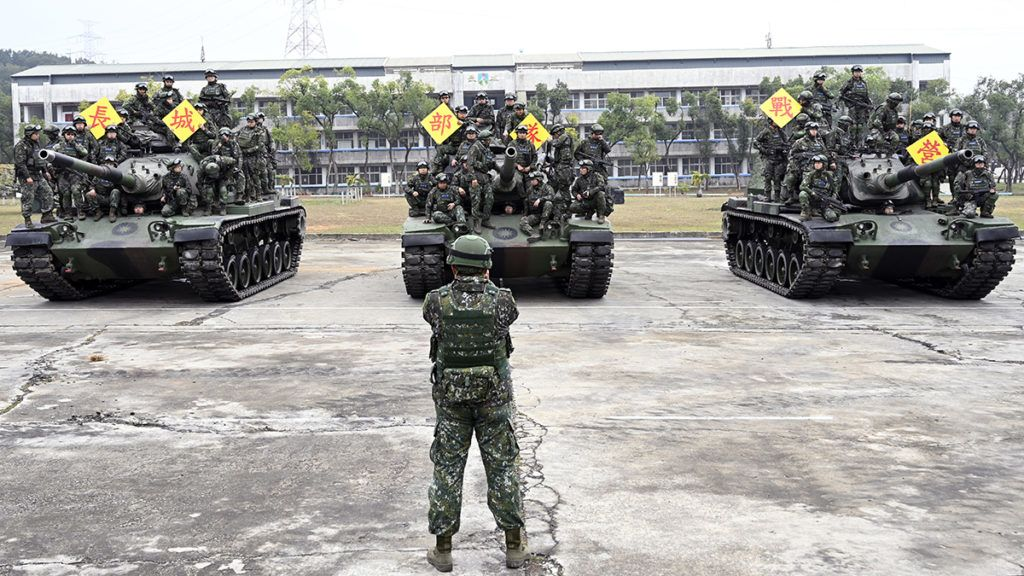 Taiwan army soldiers pose for photos on US-made M60-A3 tanks after a life-fire exercise in Taichung, central Taiwan, on January 17, 2019. (Photo by SAM YEH / AFP)