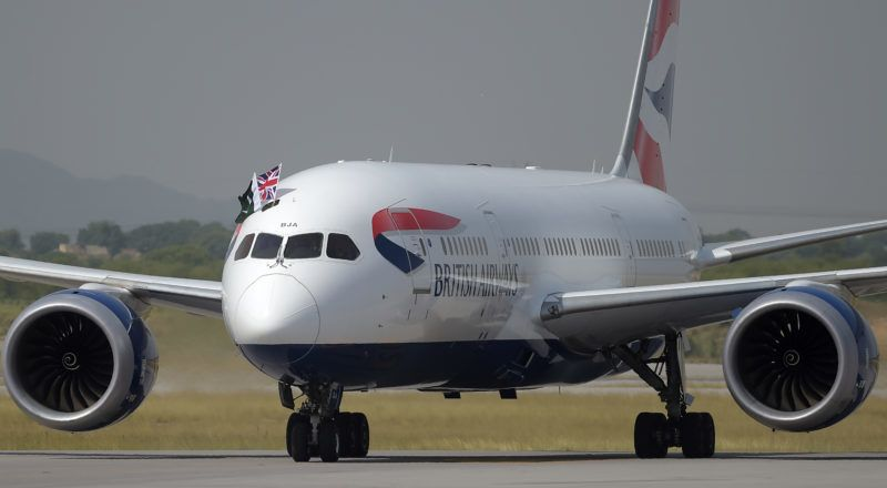 A British Airways aircraft taxies on a runway with the Pakistani (L) and Union Jack flags upon landing at the Islamabad International Airport on the outskirts of Islamabad on June 3, 2019. - British Airways landed back in Pakistan Monday, in a major vote of confidence from a Western airline after suspending operations due to security fears over a decade ago. The British carrier -- which halted services in 2008 following the deadly Marriott Hotel bombing in Islamabad -- is running three weekly flights from London's Heathrow airport to Pakistan's capital, Islamabad. (Photo by AAMIR QURESHI / AFP)
