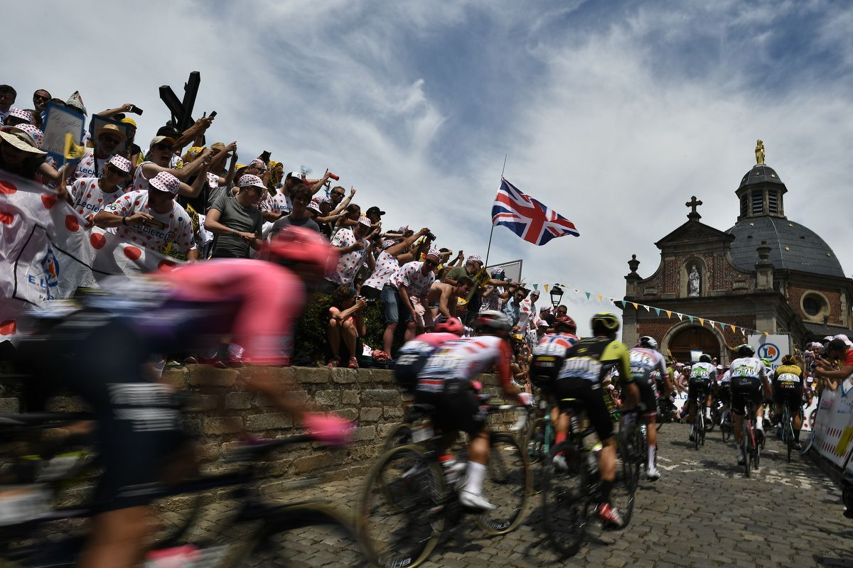 Riders from the pack in the Wall of Grammont - Mur de Grammont arrive at the chapel of Notre Dame de la Vieille Montagne - Our Lady of the Old Mountain in the first stage of the 106th edition of the Tour de France cycling race between Brussels and Brussels, Belgium, on July 6, 2019. (Photo by JEFF PACHOUD / AFP)