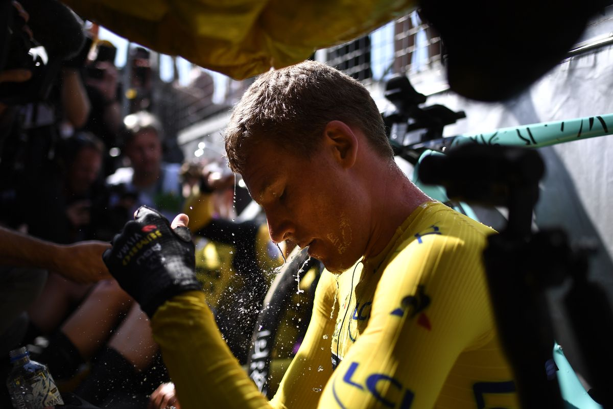 Dutch rider Mike Teunissen wearing the overall leader's yellow jersey cools off after winning with his teammates the second stage of the 106th edition of the Tour de France cycling race, a 27.6km team time-trial in Brussels, Belgium, on July 7, 2019. - Today's stage is a technically tricky team time trial with a 27.6km Brussels city-centre route. (Photo by Marco Bertorello / AFP)