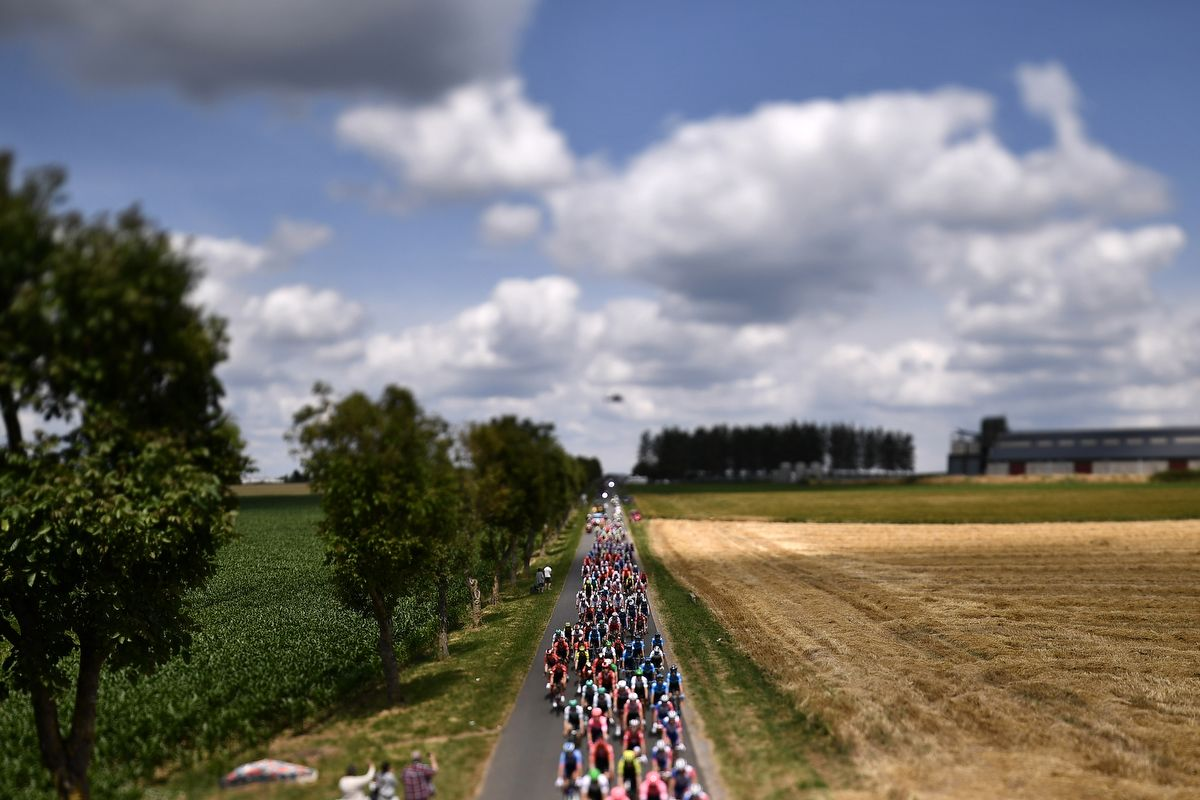 This photo taken with a tilt and shift lens shows the pack riding in the countryside during the third stage of the 106th edition of the Tour de France cycling race between Binche and Epernay, on July 8, 2019. (Photo by Marco Bertorello / AFP)