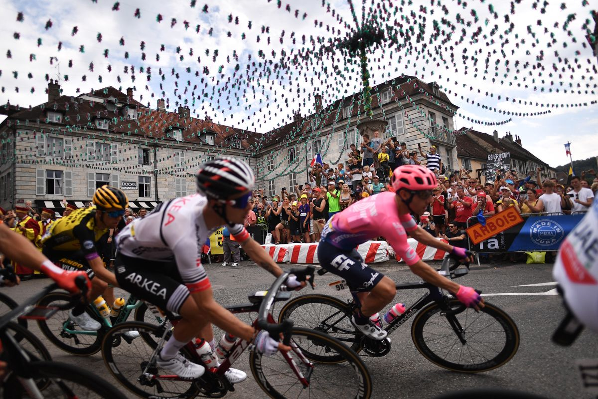 Cyclists ride on a square of Arbois, eastern France, during the seventh stage of the 106th edition of the Tour de France cycling race between Belfort and Chalon-sur-Saone, on July 12, 2019. (Photo by Marco Bertorello / AFP)