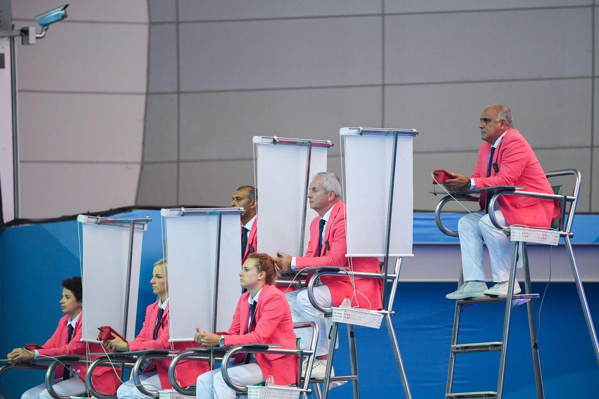 Judges watch the women's synchronised 3m springboard diving final during the 2019 World Championships at Nambu International Aquatics Centre in Gwangju on July 15, 2019. (Photo by Manan VATSYAYANA / AFP)