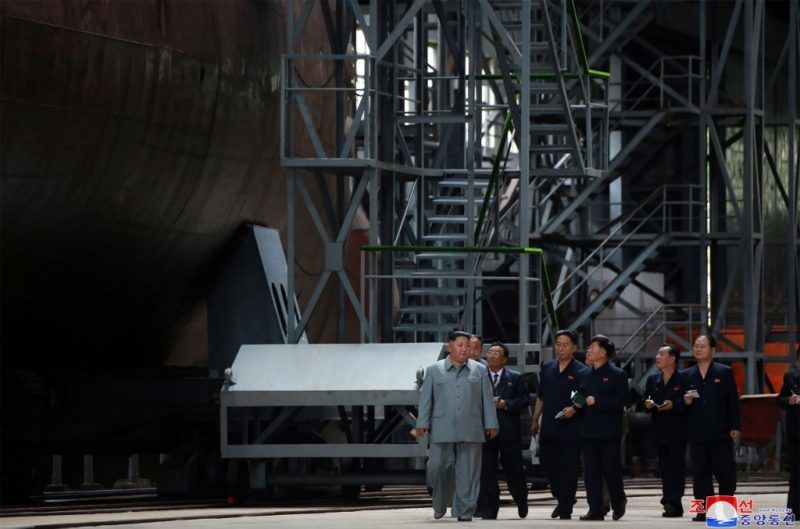 """This undated picture released from North Korea's official Korean Central News Agency (KCNA) on July 23, 2019 shows North Korean leader Kim Jong Un (L) inspecting a newly built submarine at an undisclosed location. (Photo by KCNA VIA KNS / KCNA VIA KNS / AFP) / - South Korea OUT / REPUBLIC OF KOREA OUT   ---EDITORS NOTE--- RESTRICTED TO EDITORIAL USE - MANDATORY CREDIT """"AFP PHOTO/KCNA VIA KNS"""" - NO MARKETING NO ADVERTISING CAMPAIGNS - DISTRIBUTED AS A SERVICE TO CLIENTS THIS PICTURE WAS MADE AVAILABLE BY A THIRD PARTY. AFP CAN NOT INDEPENDENTLY VERIFY THE AUTHENTICITY, LOCATION, DATE AND CONTENT OF THIS IMAGE. THIS PHOTO IS DISTRIBUTED EXACTLY AS RECEIVED BY AFP. /"""