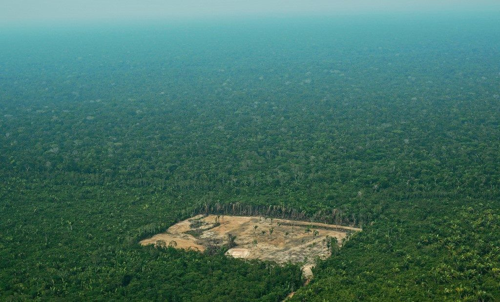 Aerial view of deforestation in the Western Amazon region of Brazil on September 22, 2017. - Parts of the Western Amazon rainforest have suffered some of the heaviest deforestion in the Amazon as a whole, with figures puting it at a third higher than last year. Illegal logging has been hard to police in a country in economic crisis. (Photo by CARL DE SOUZA / AFP) / TO GO WITH AFP STORY by PAULA RAMON