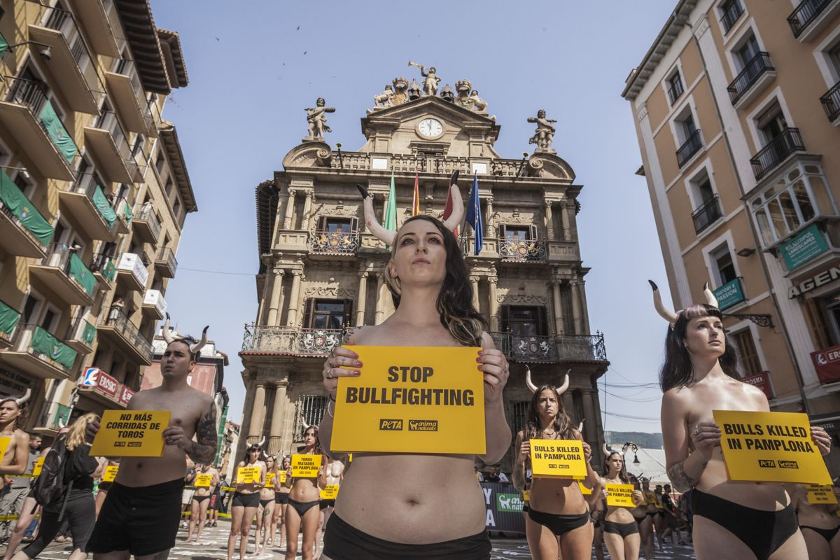 Activist against animal cruelty holds a banner anti bullfightings during a performance before the San Fermin celebrations in Pamplona, Spain, on July 5, 2019. (Photo by Celestino Arce/NurPhoto)