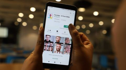 This illustration picture shows FaceApp application logo displayed on the screen of a smartphone (Photo by Nasir Kachroo/NurPhoto)