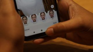 This illustration picture shows a user tries to edit her photo on FaceApp application on a smartphone (Photo by Nasir Kachroo/NurPhoto)