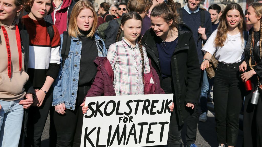 """Greta Thunberg (C, with a white placard), the Swedish 16-year-old climate activist and the figurehead of the movement """"Youth for Climate"""" takes part in a demonstration of students in front of the Paris Opera on February 21, 2019, to demand concrete measures to politicians to counter the global warming. (Photo by Michel Stoupak/NurPhoto)"""