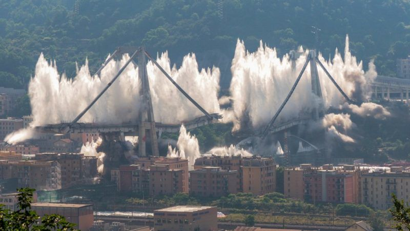 The pylons 10 and 11 of the collapsed Morandi viaduct are demolished with a controlled dynamite explosion on June 28, 2019 in Genoa, Italy. The giant motorway bridge collapsed on August 14, 2018 killing 43 people. The collapse, which saw a vast stretch of the A10 freeway tumble on to railway lines in the northern port city, was the deadliest bridge failure in Italy for years. (Photo by Mauro Ujetto/NurPhoto)