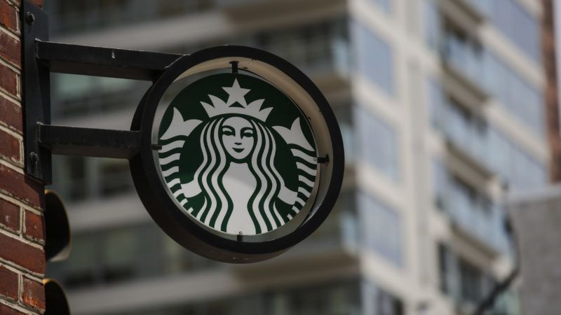 The Starbucks logo it's seen outside a store on May 29, 2018 in Philadelphia. - Starbucks is closing more than 8,000 stores across the United States Tuesday to conduct employee training on racial bias, a closely watched exercise that spotlights lingering problems of discrimination nationwide. (Photo by KENA BETANCUR / AFP)