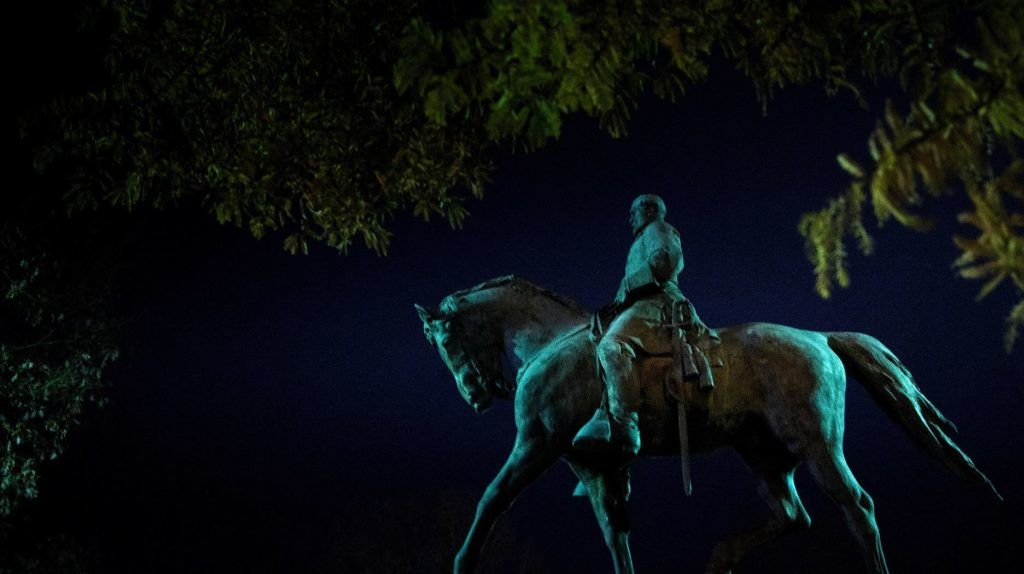 A statue of Confederate General Robert Edward Lee is seen in Market Street Park on November 25, 2018 in Charlottesville, Virginia. (Photo by Brendan Smialowski / AFP)
