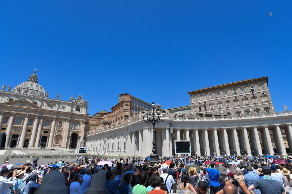 Pope Francis (Top R) addresses worshipers during the Angelus on the solemnity of Saints Peter and Paul, on June 29, 2019 from the window of the Apostolic Palace overlooking St. Peter's square in the Vatican. (Photo by Tiziana FABI / AFP)