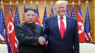 """This picture taken on June 30, 2019 and released by North Korea's official Korean Central News Agency (KCNA) on July 1, 2019 shows North Korea's leader Kim Jong Un (L) and US President Donald Trump shaking hands during a meeting on the south side of the Military Demarcation Line that divides North and South Korea, in the Joint Security Area (JSA) of Panmunjom in the Demilitarized zone (DMZ). (Photo by KCNA VIA KNS / KCNA VIA KNS / AFP) / South Korea OUT / REPUBLIC OF KOREA OUT   ---EDITORS NOTE--- RESTRICTED TO EDITORIAL USE - MANDATORY CREDIT """"AFP PHOTO/KCNA VIA KNS"""" - NO MARKETING NO ADVERTISING CAMPAIGNS - DISTRIBUTED AS A SERVICE TO CLIENTS / THIS PICTURE WAS MADE AVAILABLE BY A THIRD PARTY. AFP CAN NOT INDEPENDENTLY VERIFY THE AUTHENTICITY, LOCATION, DATE AND CONTENT OF THIS IMAGE --- /"""