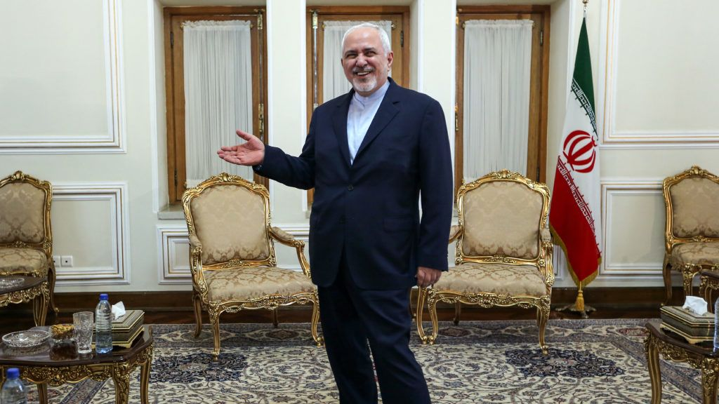 Iranian Foreign Minister Mohammad Javad Zarif gestures as he stands in an office as he meets with the diplomatic advisor to the French president in the capital Tehran on July 10, 2019. - Iran has breached a uranium enrichment cap set by a troubled 2015 nuclear deal and warned Europe against taking retaliatory measures, as France decided to send an envoy to Tehran to try to calm tensions. (Photo by ATTA KENARE / AFP)