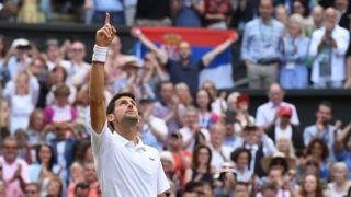 Serbia's Novak Djokovic celebrates beating Switzerland's Roger Federer during their men's singles final on day thirteen of the 2019 Wimbledon Championships at The All England Lawn Tennis Club in Wimbledon, southwest London, on July 14, 2019. (Photo by Ben STANSALL / AFP) / RESTRICTED TO EDITORIAL USE