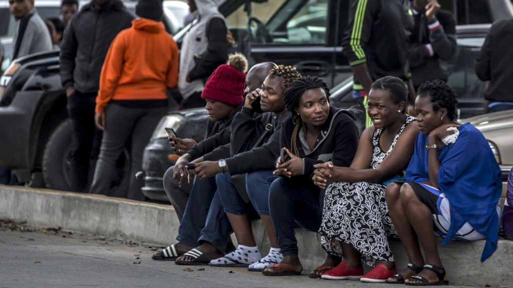 A group of migrants, mostly from African countries, wait to request an appointment with US migration authorities outside El Chaparral port of entry, in Tijuana, Baja California state, Mexico, on July 17, 2019. (Photo by OMAR MARTÍNEZ / AFP)