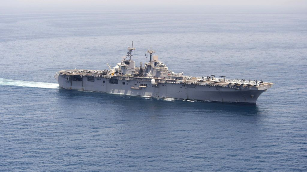 """(FILES) In this file photo taken on June 15, 2016 released by the US Navy, the amphibious assault ship USS Boxer transits The Gulf to conduct missions in support of Operation Inherent Resolve. - The US military shot down an Iranian drone on July 18, 2019 that came within 1,000 yards of one of its naval vessels in the Strait of Hormuz, President Donald Trump said.""""The (USS) Boxer took defensive action against an Iranian drone which had closed into a very, very near distance, approximately 1,000 yards,"""" Trump announced at the White House. (Photo by Craig Z. Rodarte / US NAVY / AFP) / RESTRICTED TO EDITORIAL USE - MANDATORY CREDIT """"AFP PHOTO /US NAVY/Greg Z. RODARTE/HANDOUT"""" - NO MARKETING NO ADVERTISING CAMPAIGNS - DISTRIBUTED AS A SERVICE TO CLIENTS"""