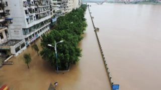 This photo taken on July 18, 2019 shows a flooded street in Dazhou City, in China's southwest Sichuan Province. - Heavy rainfall from July 16-18 caused flooding in Dazhou, with more than 2000 people forced to evacuate. (Photo by - / AFP) / China OUT