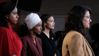 """WASHINGTON, DC - JULY 15: (L-R) U.S. Reps. Ayanna Pressley (D-MA), Ilhan Omar (D-MN) and Alexandria Ocasio-Cortez (D-NY) listen as Rep. Rashida Tlaib (D-MI) pauses while speaking at a news conference at the U.S. Capitol on July 15, 2019 in Washington, D.C. President Donald Trump stepped up attacks on the four progressive Democratic congresswomen, saying that if they're not happy in the U.S., """"they can leave.""""   Alex Wroblewski/Getty Images/AFP"""