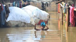 A Kid wade through flood water area at Ragailong Colony in Dimapur, India north eastern state of Nagaland on Saturday, 06 July 2019. The monsoon rain which hit the South East Asia region from June to September causes massive disaster every year.   (Photo by Caisii Mao/NurPhoto)