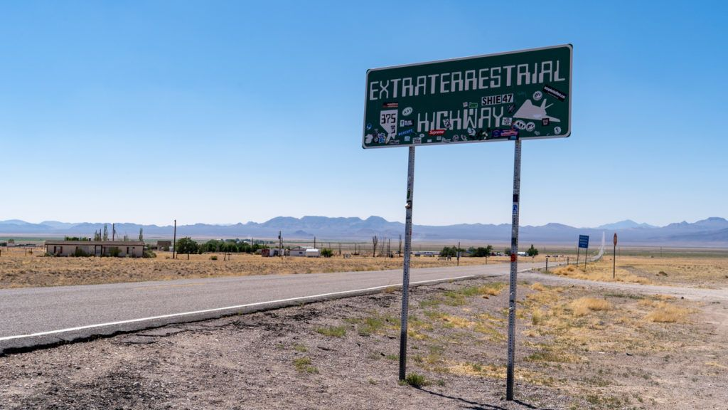 Rachel, Nevada - July 4, 2018: Landmark sign for the Extraterrestrial Highway is covered in stickers from tourists exploring this stretch of road known for Area 51 and UFO sightings