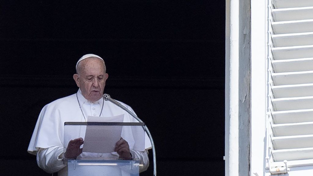 Pope Francis addresses the crowd from the window of the apostolic palace overlooking Saint Peter's square in the Vatican during his Sunday Angelus prayer on July 21, 2019. (Photo by Tiziana FABI / AFP)