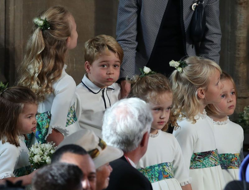 WINDSOR, ENGLAND - OCTOBER 12: The bridesmaids and page boys, including Prince George (C-L) and Princess Charlotte (L), arrive ahead of the wedding of Princess Eugenie of York and Mr. Jack Brooksbank at St. George's Chapel on October 12, 2018 in Windsor, England. (Photo by Yui Mok - WPA Pool/Getty Images)