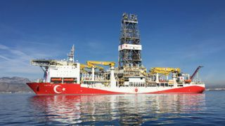 The Fatih oil drilling ship prepares to sail to the contested waters of the Mediterranean Sea for oil and gas drilling operations near Anatalya, Turkey, on Tuesday, Oct. 30, 2018. Turkeys first deep-sea drilling ship, flanked by Turkish war vessels, set sail Tuesday looking for natural gas and oil in contested waters of the Mediterranean, a launch liable to exacerbate longstanding tensions with Greece. Photographer: Firat Kozok/Bloomberg via Getty Images