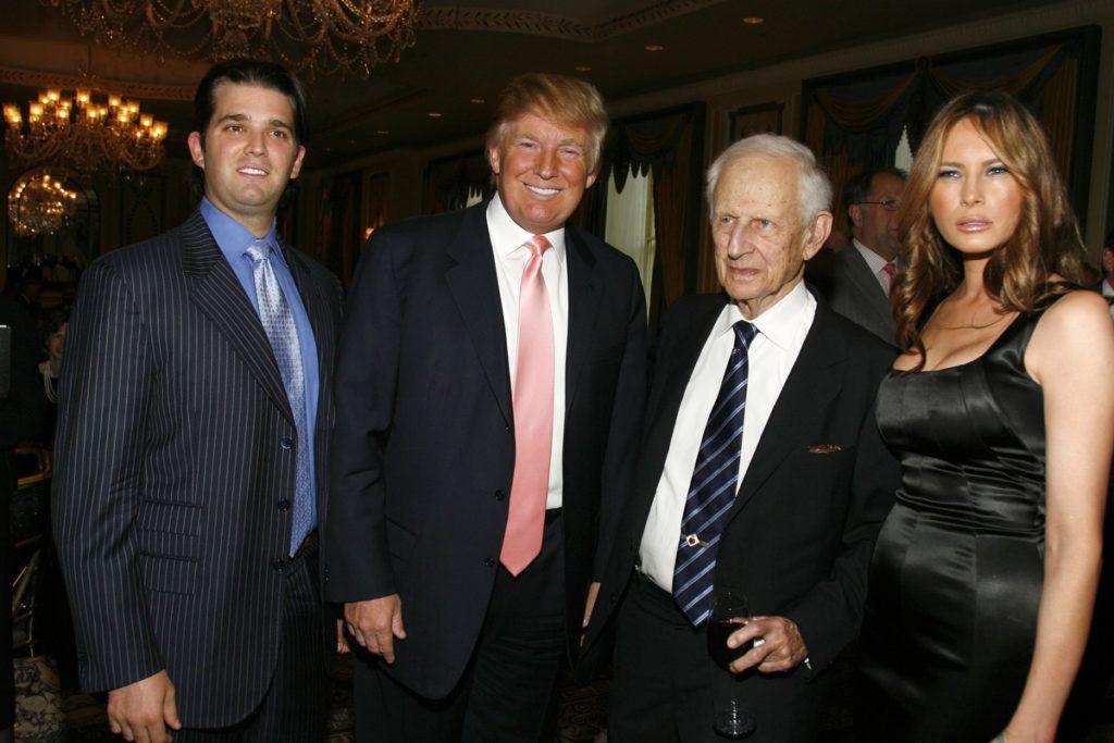Donald Trump Jr., Donald Trump, Manhattan district attorney and PAL chairman Robert M. Morgenthau and Melania Trump (Photo by M. Von Holden/WireImage)