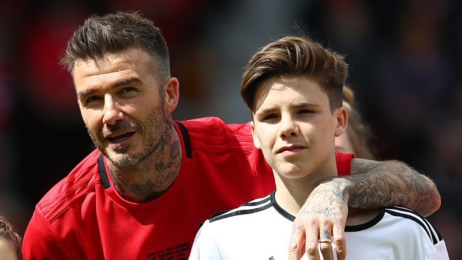 MANCHESTER, ENGLAND - MAY 26: David Beckham of Manchester United '99 Legends pictured with his children Harper and Cruz during the Manchester United '99 Legends and FC Bayern Legends match at Old Trafford on May 26, 2019 in Manchester, England. (Photo by Matthew Lewis/Getty Images)