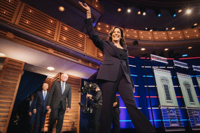 Senator Kamala Harris, a Democrat from California and 2020 presidential candidate, center, arrives on stage for the Democratic presidential candidate debate in Miami, Florida, U.S., on Thursday, June 27, 2019. Former U.S. Vice President Joe Biden opened the second night of the Democratic presidential debates with a direct attack on PresidentDonald Trump's handling of the economy, setting the tone for a night in which he and nine other hopefuls sought to demonstrate for voters the stark choice they will have in the 2020 election. Photographer: Jayme Gershen/Bloomberg via Getty Images