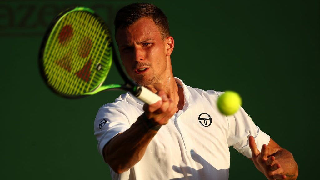 LONDON, ENGLAND - JULY 04: Marton Fucsovics of Hungary plays a forehand in his Men's Singles second round match against  Fabio Fognini of Italy during Day four of The Championships - Wimbledon 2019 at All England Lawn Tennis and Croquet Club on July 04, 2019 in London, England. (Photo by Clive Brunskill/Getty Images)